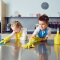 A young boy and girl cleaning a kitchen worktop